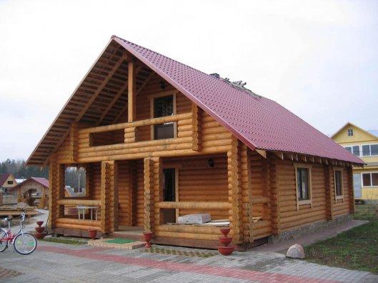 Строительство деревянного дома из оцилиндрованных бревен